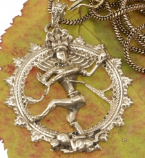 Amulet with chain `dancing Shiva in the fire wreath`, golden trib..