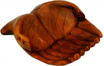 Carved hands, wooden bowl hand